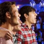 Young men watching match — Stock Photo #52589389