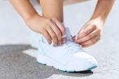 Sport woman tying shoelace — Stock Photo