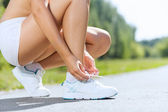 Sport woman tying shoelace — Stock Photo