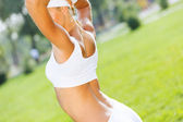 Sport girl in white sport wear — Stock Photo