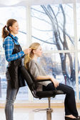 Young woman and hairdresser — Stock Photo