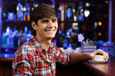 Handsome man at bar — Stock Photo