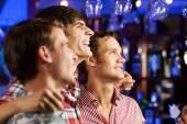 Young men watching match — Stock Photo
