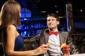 Elegant man and woman in bar — Stock Photo