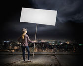 Woman carrying blank banner — Stock Photo