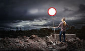 Woman holding road sign — Stock Photo