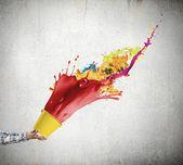 Hand splashing colorful paint — Stok fotoğraf