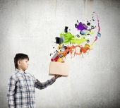 Boy splashing colorful paint — Stockfoto