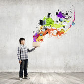 Boy splashing colorful paint — Foto Stock