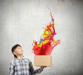 Boy splashing colorful paint — Foto de Stock