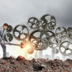 Businessman fixing gears mechanism — Stock Photo #52673869