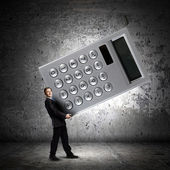 Businessman carrying big calculator — Foto Stock