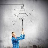 Woman ringing bell — Stock Photo