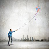 Woman playing with kite — Stock Photo