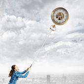 Woman with pocket watch — Stockfoto