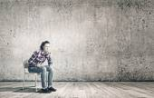 Woman sitting on chair — Stock Photo