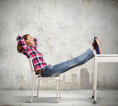 Woman with legs on table — Stock Photo
