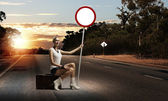 Young woman with road sign — Foto Stock