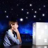 Boy looking at model of house — Stock Photo