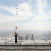 Businesswoman looking at broken ladder — Stock Photo