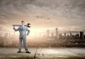 Businessman with wrench — Stock Photo