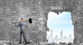 Businessman with big hammer in hands — Stock Photo