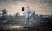Businessman with hammer — Stock Photo
