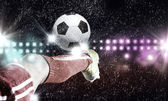 Footballer foot kicking ball — Stock Photo