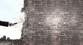 Businessman hand crashing brick wall — Stock Photo