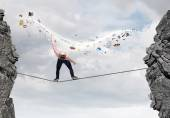 Man evading from flying icons — Stock Photo