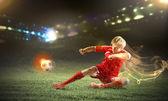 Football player doing slide tackle — Stock Photo