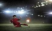 Football player on stadium — Stock Photo