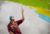 Woman with paintbrush — Stock Photo