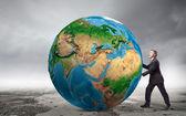 Kaufmann schieben große erde planet — Stockfoto