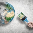 Business person hand painting Earth planet — Stock Photo #54375339