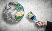 Business person hand painting Earth planet — Stock Photo