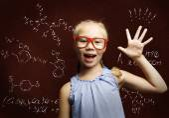 Wunderkind girl in school — Stock Photo