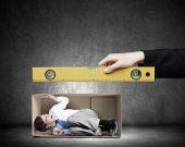 Businessman in carton box — Stock Photo