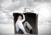 Man in box — Stock Photo