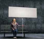 Woman with banner — Stock Photo