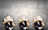 People with boxes on head — Stock Photo