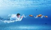 Swimming businessman — Stock Photo