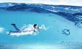 Swimming businessman — Photo
