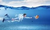 Swimming businessman — Стоковое фото