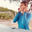 Looking for a music to get inspired for a run — Stock Photo #65599205