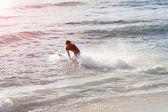 Hitting waves — Stock Photo