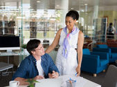 Expert is ready to help him with her work — Stock Photo