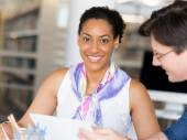 Expert is ready to help her with her work — Stock Photo
