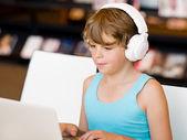 Boy spending time with notebook — Stok fotoğraf