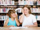 Teenage girl and her brother with books — Stock Photo
